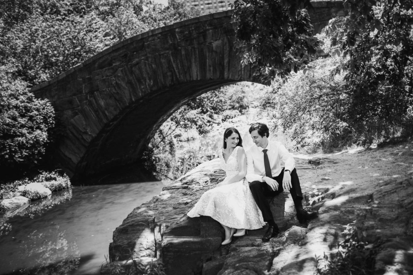 portrait of kasia and ben sitting in central park during their elopement shoot
