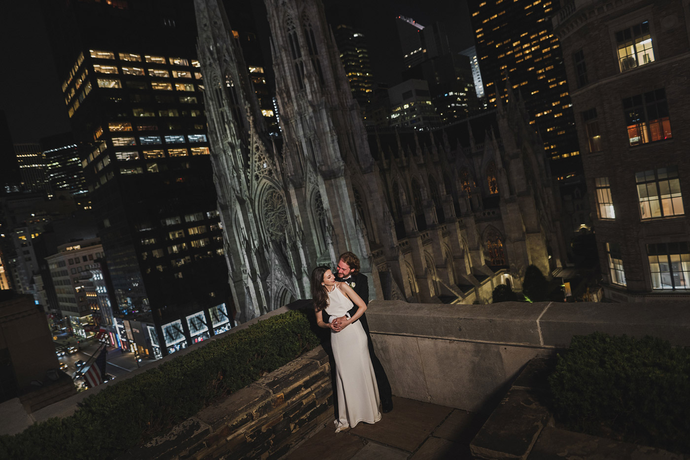 Portrait of bride and groom at 620 loft & garden with St. Patrick's in the background.