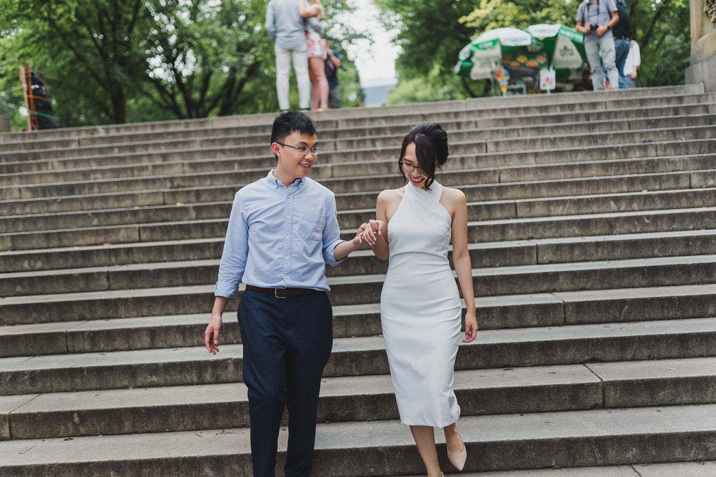 Walking down the steps of Bethesda Terrace in Central Park, right after their proposal.