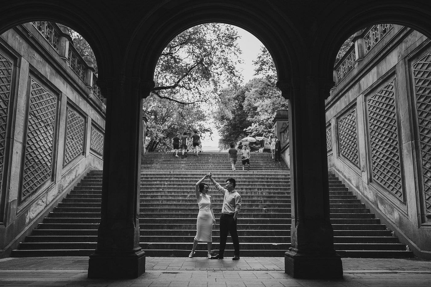 Dancing shot of couple at Bethesda Terrace after their proposal in Central Park.