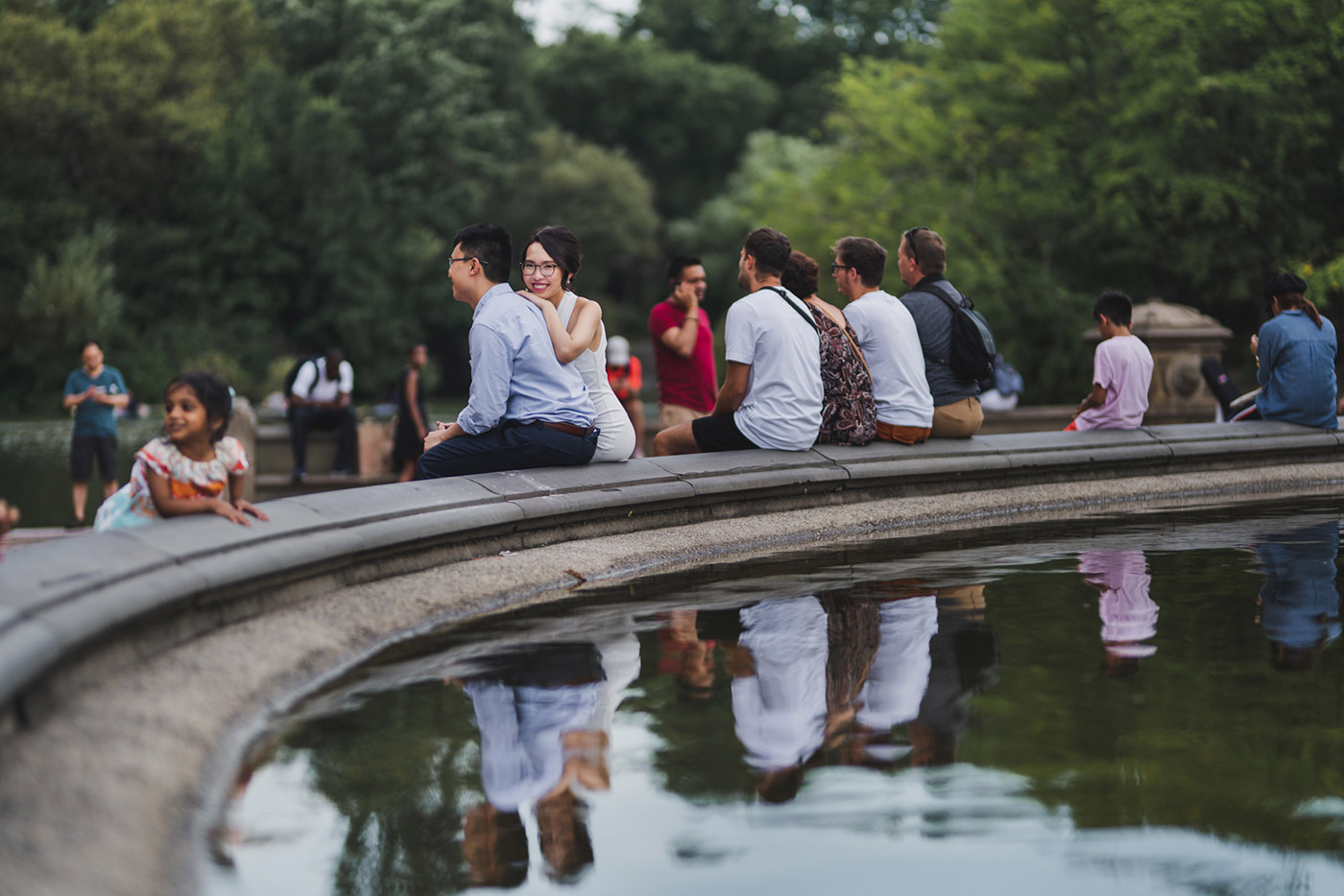 Newly engaged couple at Bethesda Fountain in Central Park, right after their proposal