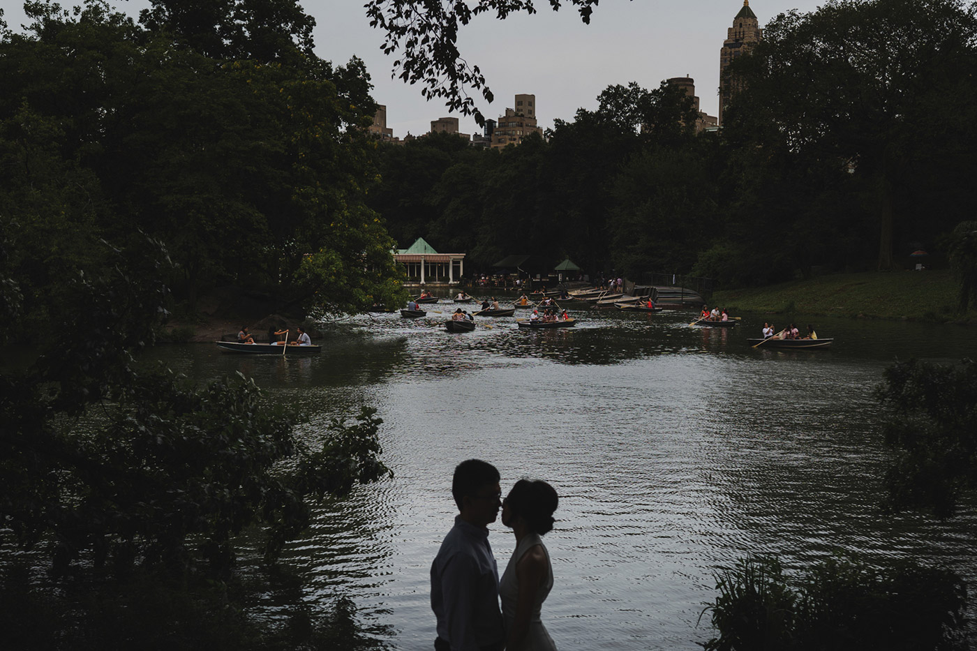 Portrait of a couple right after their proposal in Central Park. Taken by the boats by Bethesda