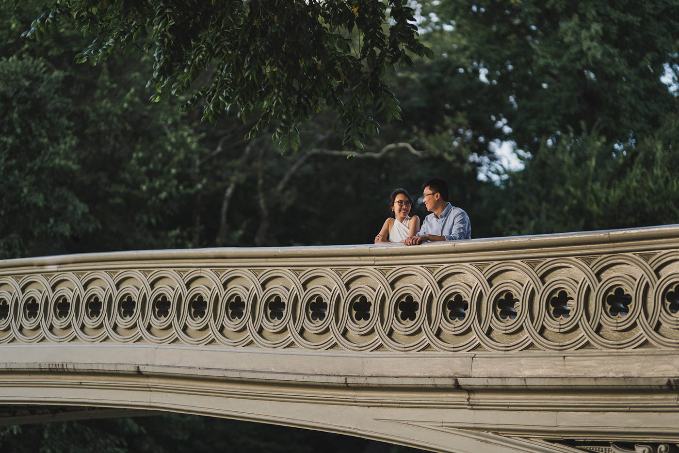 Newly engaged couple at Bow Bridge in Central Park, right after their proposal