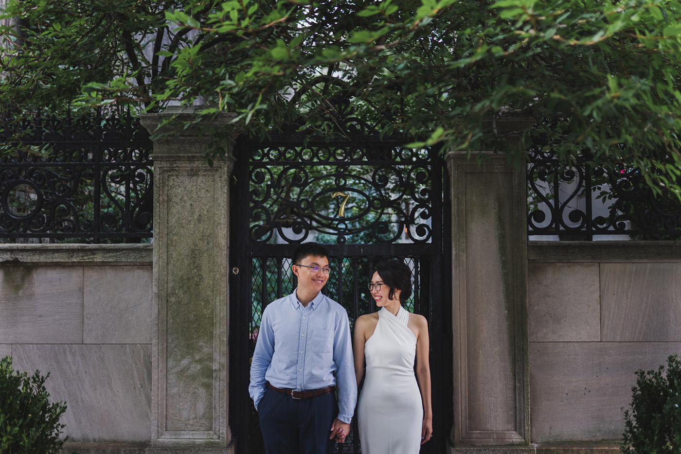 Photo of a newly engaged couple at a quiet street off of Central Park, right after their proposal