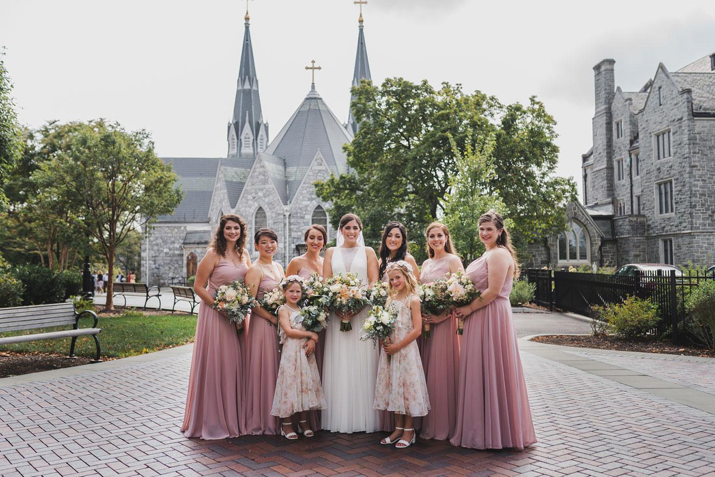 bride and bridesmaids from a wedding at Saint Thomas of Villanova by Weddings by Hanel