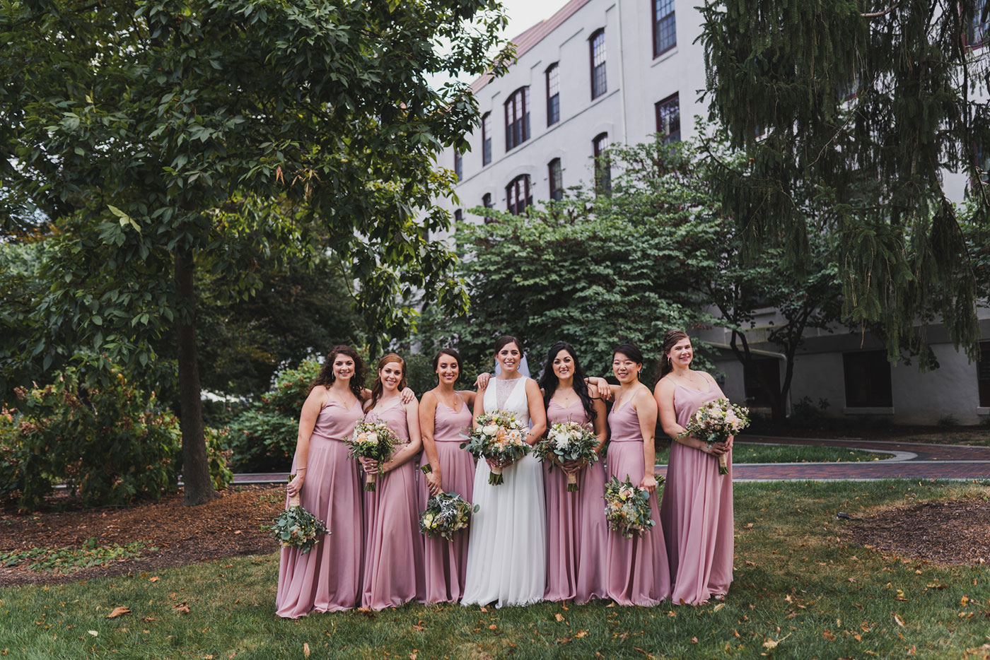 bride and her bridesmaids from a wedding at Saint Thomas of Villanova by Weddings by Hanel