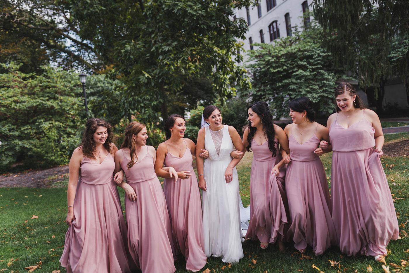 bride and bridesmaids walking from a wedding at Saint Thomas of Villanova by Weddings by Hanel