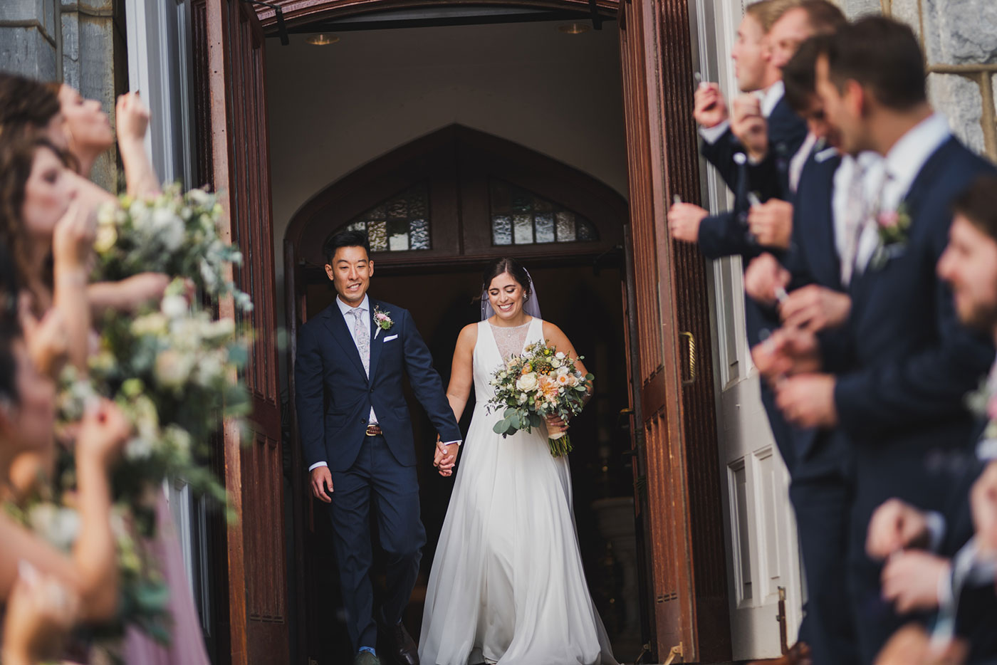 exiting from a wedding at Saint Thomas of Villanova by Weddings by Hanel