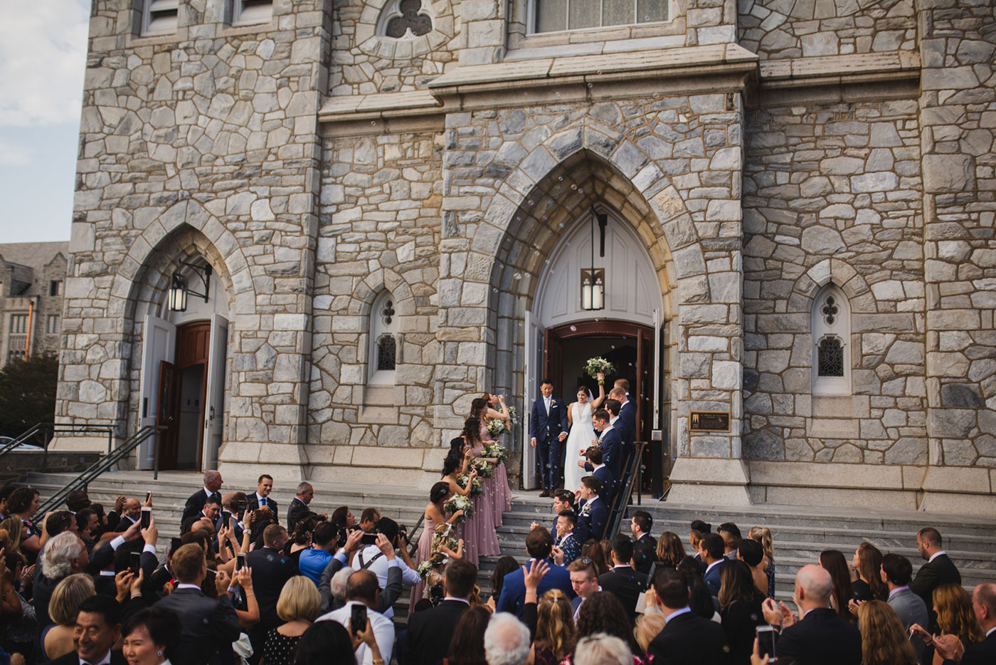 grand exit from a wedding at Saint Thomas of Villanova by Weddings by Hanel