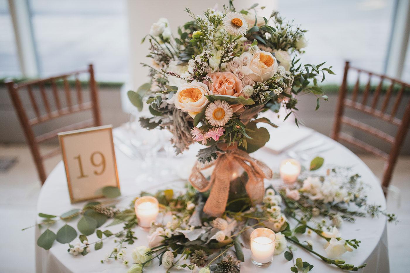 reception table setting at a wedding at Saint Thomas of Villanova by Weddings by Hanel