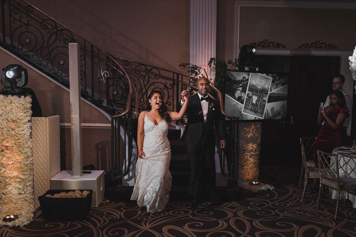 bride and groom walking in at the palace at Somerset park by weddings by H