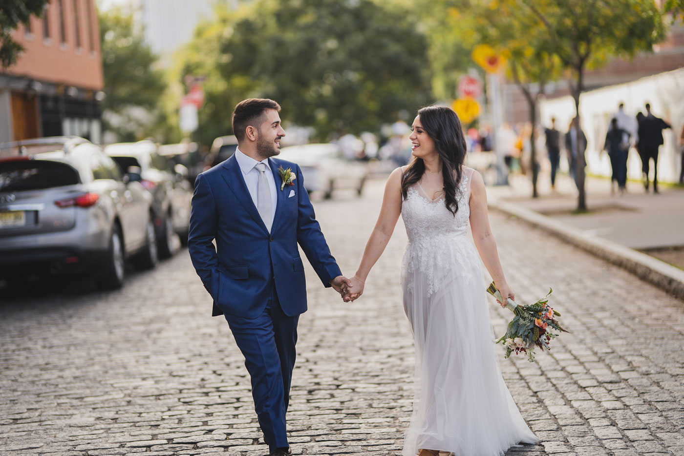 Portrait of bride and groom at an elopement at Jane's Carousel in Brooklyn Bridge Park by Weddings by Hanel