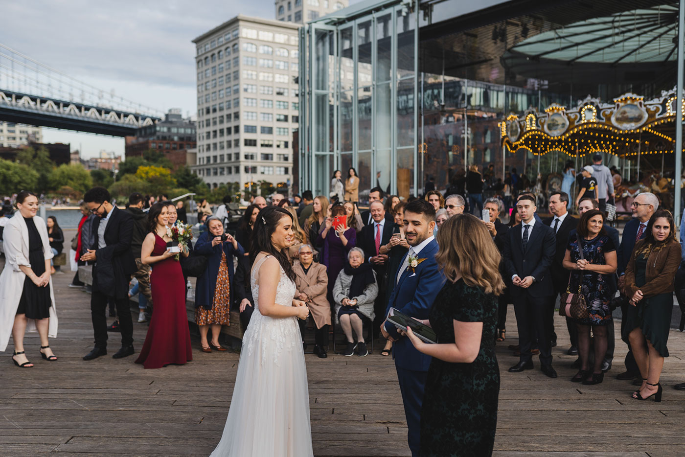 ceremony Portrait of bride and groom at an elopement at Jane's Carousel in Brooklyn Bridge Park by Weddings by Hanel