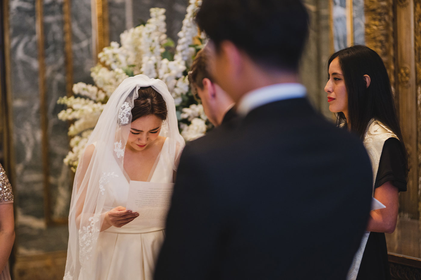 Reading vows at the James Burden Kahn Mansion by Weddings by Hanel