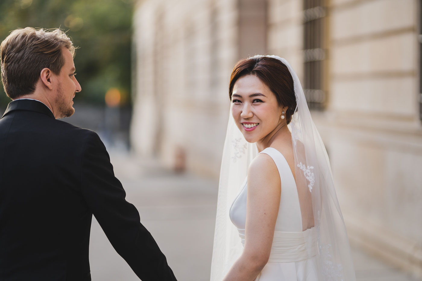 bride and groom walking at the James Burden Kahn Mansion by Weddings by Hanel