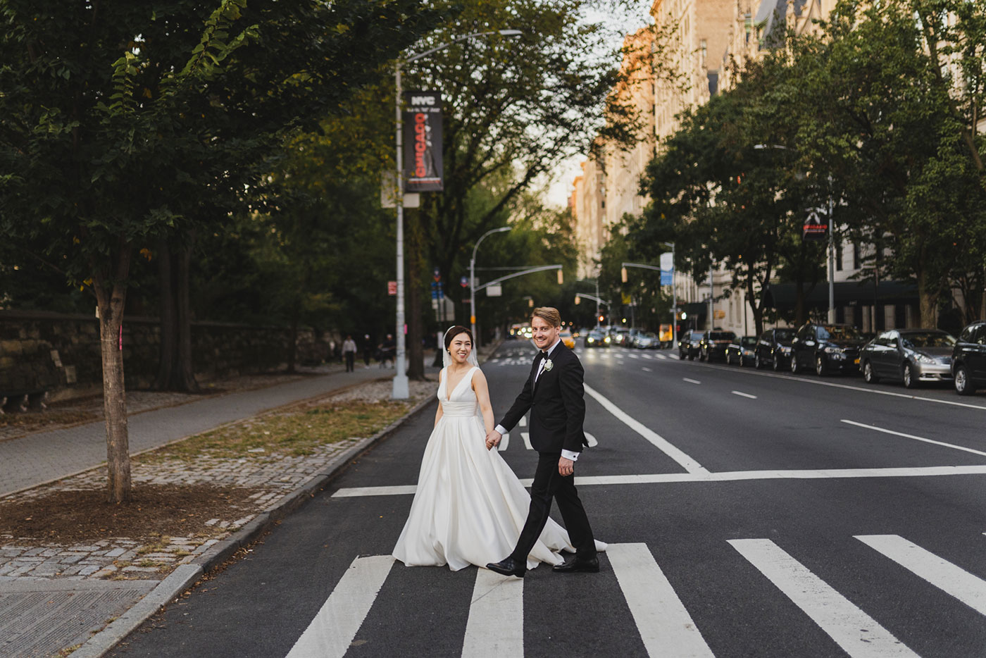 bride and groom crossing the street at the James Burden Kahn Mansion by Weddings by Hanel