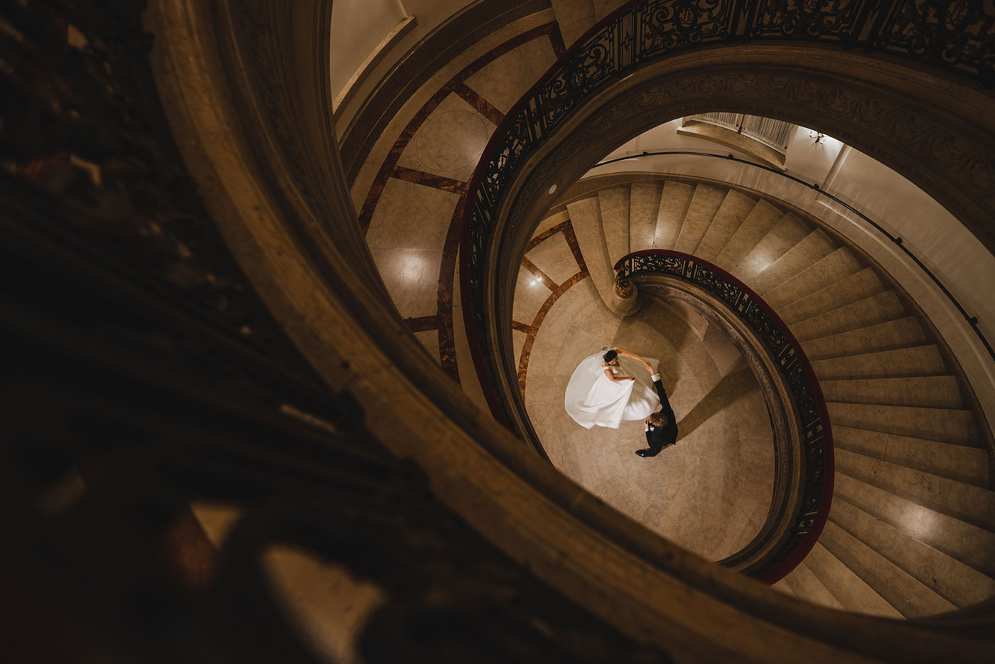 spiral staircase portrait of bride and groom at the James Burden Kahn Mansion by Weddings by Hanel