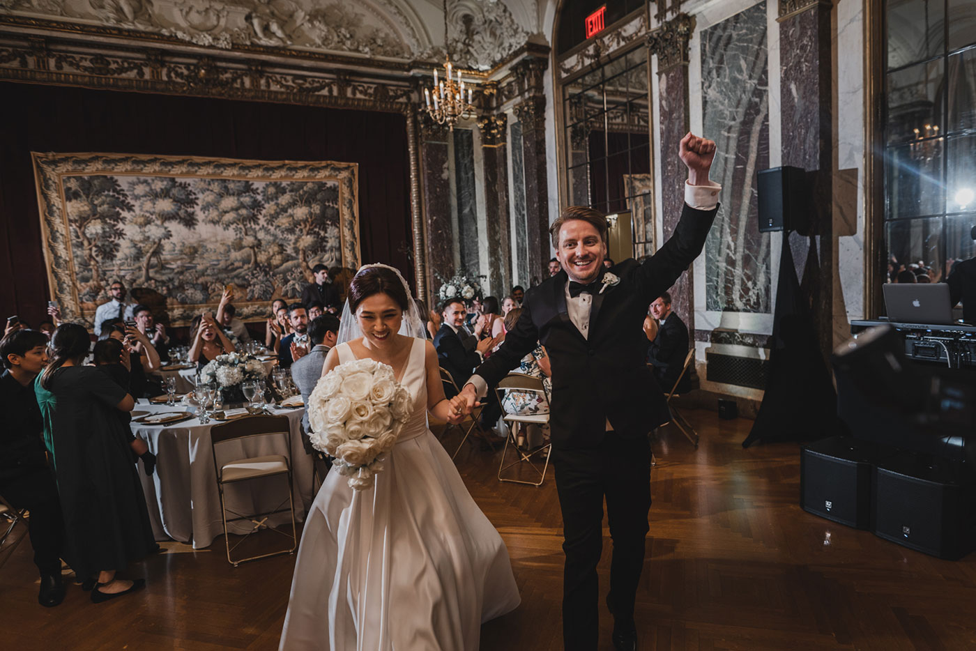 bride and groom grand entrance at the James Burden Kahn Mansion by Weddings by Hanel