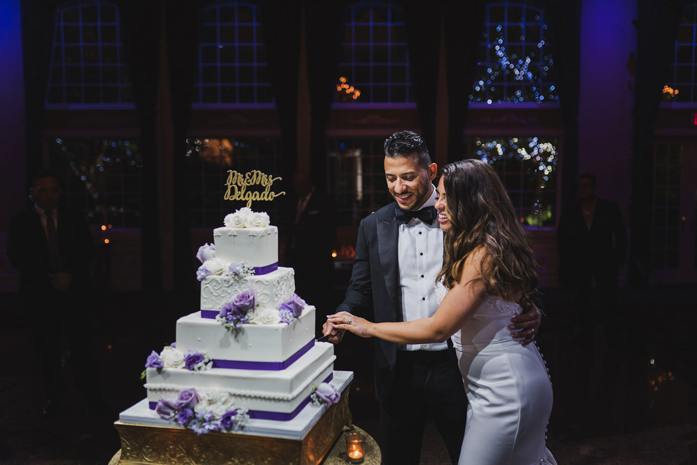 cutting the cake at the Estate at Florentine Gardens by Weddings by Hanel