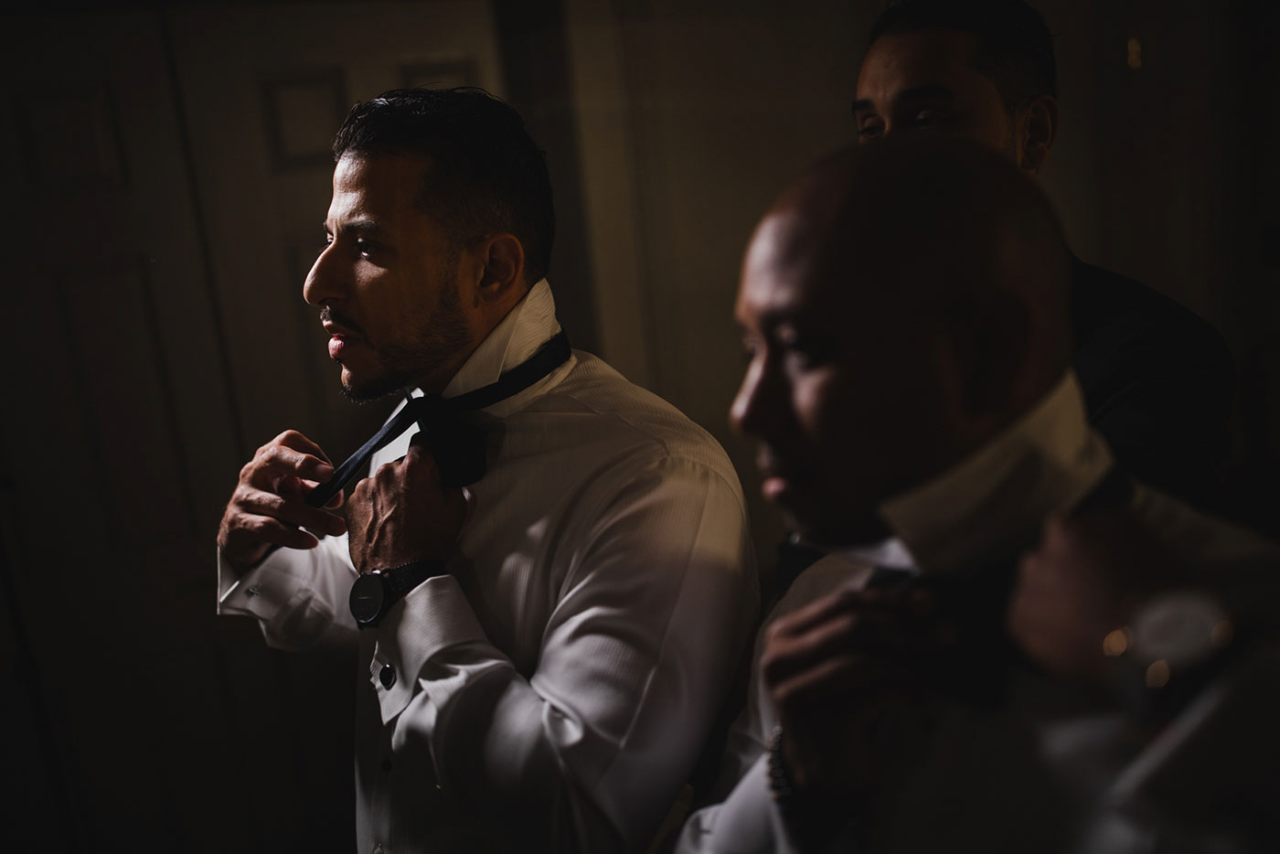 groom tying bow tie at the Estate at Florentine Gardens by Weddings by Hanel