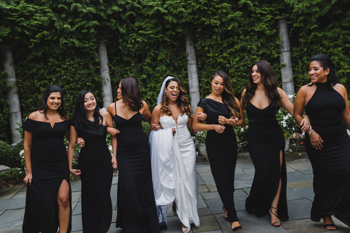 fun walking shot of bride and bridesmaids at the Estate at Florentine Gardens by Weddings by Hanel