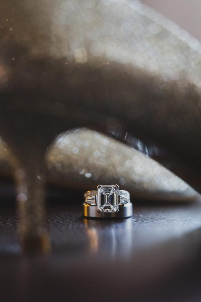 stunning ring detail shot through wedding shoes by hanel