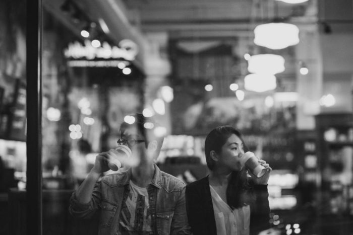 jinhee and andy coffee shop engagement photo in soho