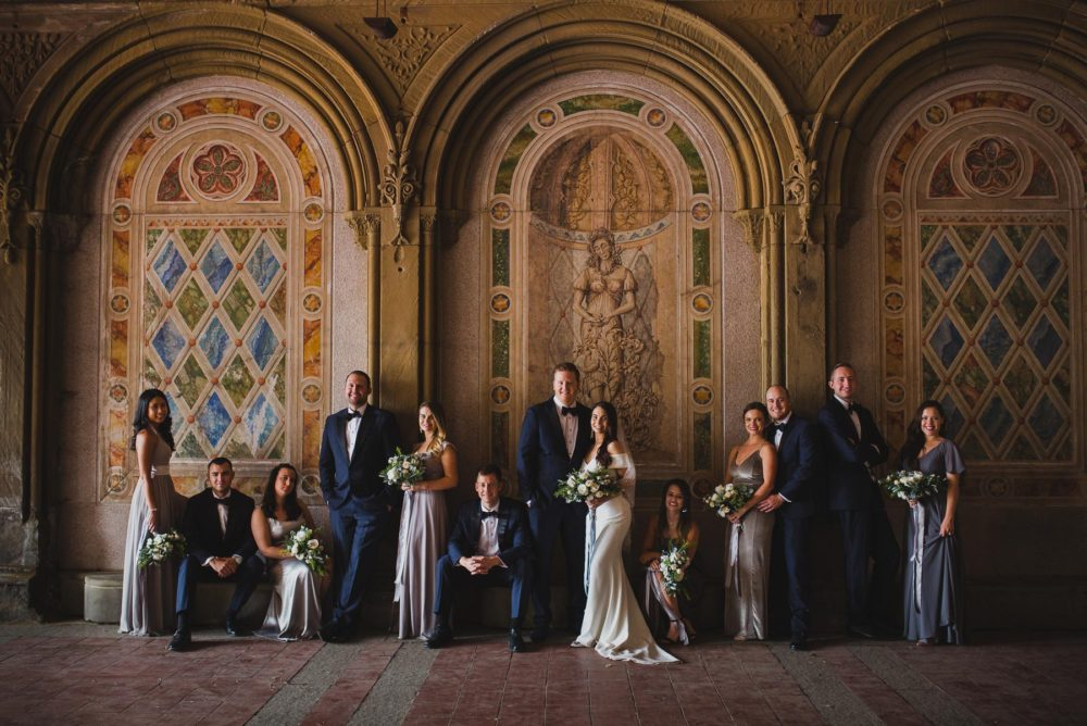 posing bridal party at bethesda terrace