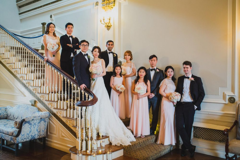 posing bridal party on the steps at bourne mansion